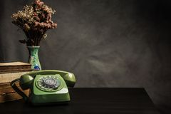 Vintage old phone on the table , still life Royalty Free Stock Photo