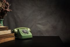 Vintage old phone on the table , still life Stock Photo