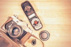 Vintage old photo-camera and accessories. Royalty Free Stock Photos