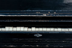 Vintage old piano. Worn piano keys. Black piano. stock photo