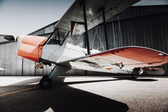 Vintage old plane side view. Wings view. Classic vintage airplane at the hangar stock images