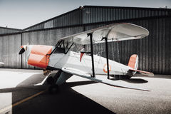 Vintage old plane side view. Wings view. Retro plane at the hangar door Royalty Free Stock Photo