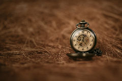 Vintage Old Pocket watch. On brown background royalty free stock photo