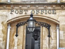Vintage old post office building with sign on entrance. With lantern light stock photos