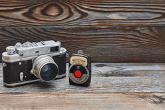 Vintage old retro 35mm rangefinder camera and light meter. On wooden background with copy space Stock Images