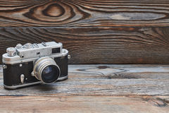 Vintage old retro rangefinder camera on wooden background Stock Image