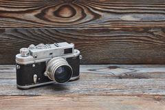 Vintage old retro rangefinder camera on wooden background. Vintage old retro 35mm rangefinder camera on wooden background with copy space Royalty Free Stock Photography