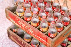 Vintage Old retro style Coca-Cola glass bottle. Empty vintage Old retro style Coca-Cola glass bottle in wooden box sold in Thailand Stock Photography
