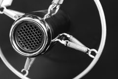 Vintage old round studio voice microphone, black and white. Vintage retro style old metal professional studio vocal voice and music recording microphone Stock Image