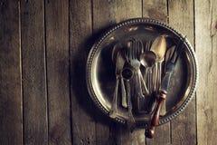 Vintage Old Rustic Kitchen Utensils Forks Spoons and Knifes on O Stock Image