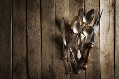 Vintage Old Rustic Kitchen Utensils Forks Spoons and Knifes on O Royalty Free Stock Photo