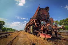 Vintage old rusty steam train under blue sky Stock Photos