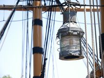 Vintage old sailboat lantern with mast and ropes. In the background royalty free stock images