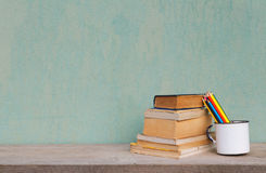 Vintage old school. Old cup with books and crayons vintage concept Royalty Free Stock Photos