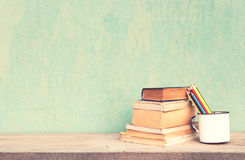 Vintage old school. Old cup with books and crayons vintage concept Royalty Free Stock Photography