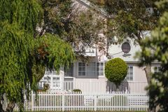 Vintage old Settlement House, Circa Early 1900`s, Flinders Bay Augusta, Western Australia. Historical White Picket Fence, in front of Restored House. Vintage stock photography