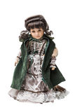 Vintage old smart porcelain doll toy in beautiful textile dress Stock Photos