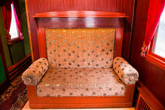 Vintage old sofa in the compartment interior Royalty Free Stock Photos
