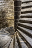 Vintage old spiral stone staircase in the style of grunge Royalty Free Stock Image