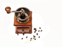 The Vintage Old Stile Wooden Coffee Grinder with Beans of Coffe on the White Background,Top View Royalty Free Stock Photography