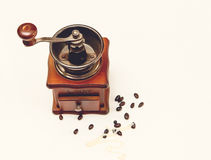 The Vintage Old Stile Wooden Coffee Grinder with Beans of Coffe on the White Background,Top View Royalty Free Stock Images