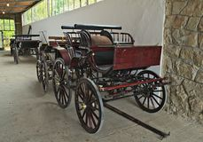 Vintage old style chariots in barn royalty free stock image