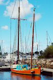 Historical vintage old style sailing boat. Vintage old style sailing boat berthed at tin Can Bay, Queensland, Australia. Brilliant blue sky backdrop and green royalty free stock images
