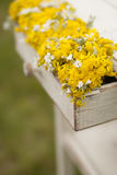 Vintage old table and wild flowers. Outdoor Stock Image