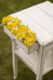 Vintage old table and wild flowers. Outdoor Stock Images
