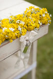 Vintage old table and wild flowers. Vintage old table and wild yellow  flowers Stock Images