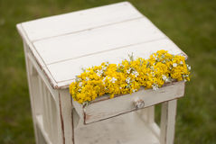 Vintage old table and wild flowers. Vintage old table and wild yellow  flowers Stock Photos