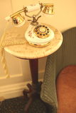 Vintage old telephone on a marble table stock images