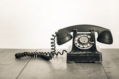 Vintage old telephone on wooden table Royalty Free Stock Image
