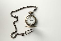 Vintage old watch on a chain. hand holding a watch on a chain. Royalty Free Stock Image