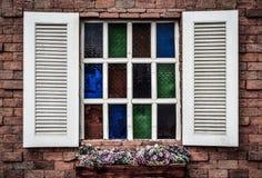 Vintage old white window on old brick wall Stock Photos