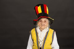Free Vintage Old Woman Wearing Cylinder And A Yellow Vest Stock Photos - 140639483