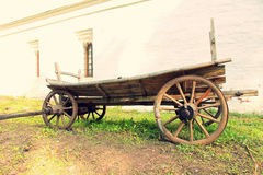 Vintage old wooden cart.Toned image. Royalty Free Stock Photo