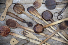 vintage old wooden cooking utensils group table Royalty Free Stock Image