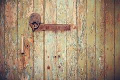 Vintage old wooden door. Closeup vintage old wooden door in grungy style royalty free stock image