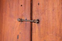 Vintage of old wooden door and door latch Stock Image
