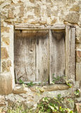 Vintage old wooden gate closed. Detail of vintage old wooden gate in a stone wall Royalty Free Stock Images