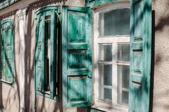 Vintage old wooden window open shutters stock photography