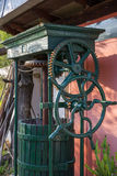 Vintage olive press with wooden barrel, close up Stock Photography