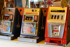 Vintage one arm bandits. Row of vintage one arm bandits, fruit machines Royalty Free Stock Photos
