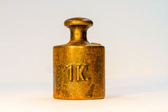 Vintage One Kilogram Golden Calibration Weight. On White Background Stock Image