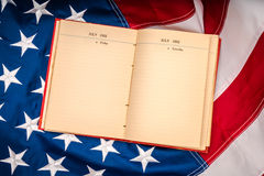 .Vintage open book on American flag Royalty Free Stock Photos