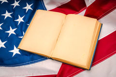 .Vintage open book on American flag Royalty Free Stock Photography