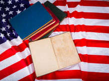 Vintage open book on American flag free Royalty Free Stock Image