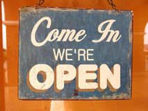 Vintage open sign board word `Come in We`re Open` Stock Photos