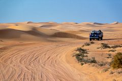 Vintage open top 4x4 SUV in the desert in Dubai, UAE royalty free stock images